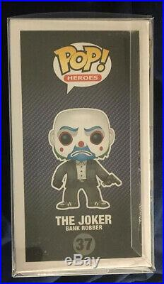 Funko Pop! The Dark Knight The Joker Bank Robber with Soft Pop Protector