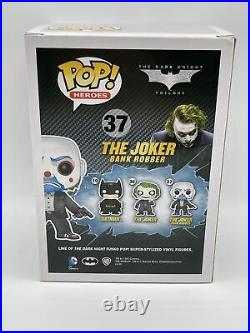 Funko Pop! The Joker Bank Robber #37 The Dark Knight. Pop has paint defect